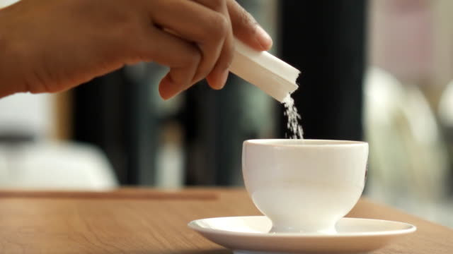 hd super slow motion sugar pouring in to coffee - sugar stock videos & royalty-free footage