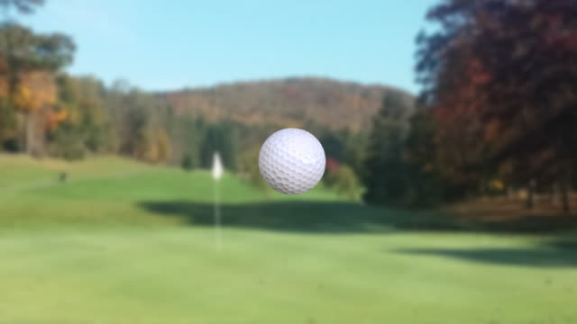 Super slow motion video, golf ball moving to putting green