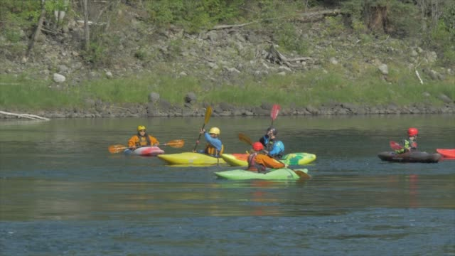 super slow motion view of canoe rafters on clearwater river at clearwater, british columbia, canada, north america - wide shot stock videos & royalty-free footage