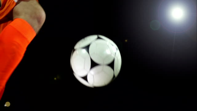 Super Slow Motion, Volley Football / Soccer ball under Floodlights