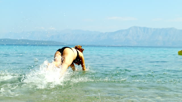 ms super slow motion woman diving into sunny ocean,peljesac,croatia - swimwear stock videos & royalty-free footage