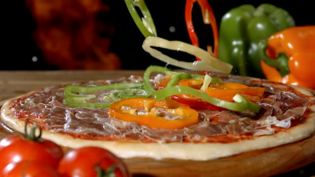 hd super slow-mo: adding slices of pepper on pizza - pizza oven stock videos and b-roll footage