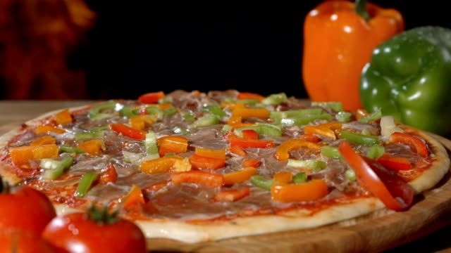 hd super slow-mo: adding slices of tomato on pizza - hearth oven stock videos & royalty-free footage