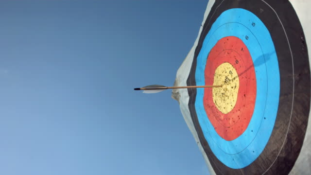 hd super slow-mo: arrow hitting center of target - pointing stock videos & royalty-free footage