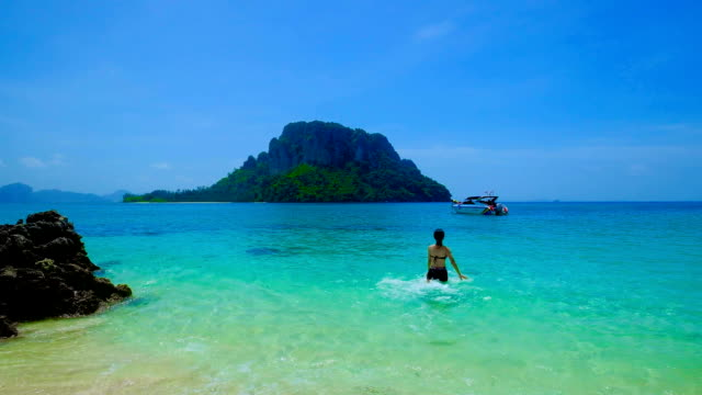 HD Super Slow-Mo: Asian Young Woman Having Fun on beautiful beach in Krabi, Thailand