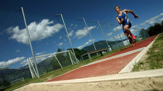 hd super slow-mo: athlete taking off for a long jump - pole stock videos & royalty-free footage