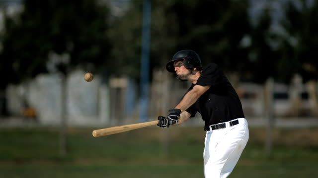 hd super slow-mo: baseball batter hitting ball - hitting stock videos & royalty-free footage