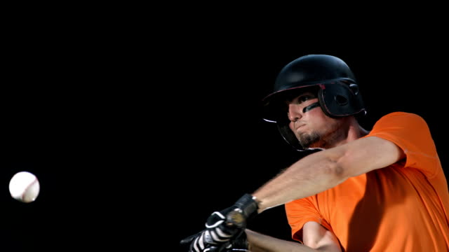 hd super slow-mo: baseball player on black background - hitting stock videos & royalty-free footage