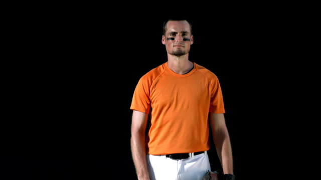 hd super slow-mo: baseball player standing for national anthem - baseball cap stock videos & royalty-free footage