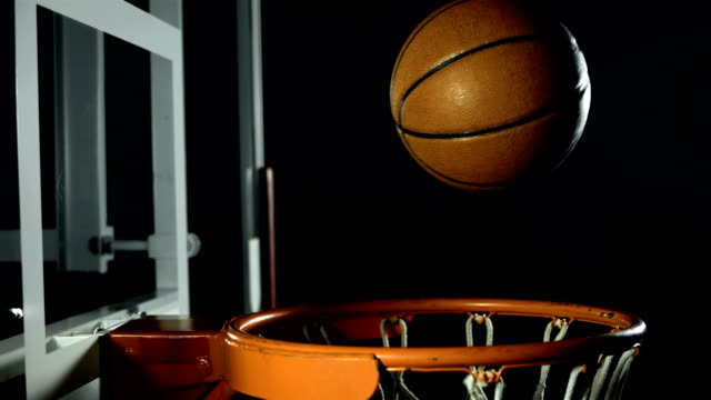hd super slow-mo: basketball falls through a hoop - basket stock videos & royalty-free footage