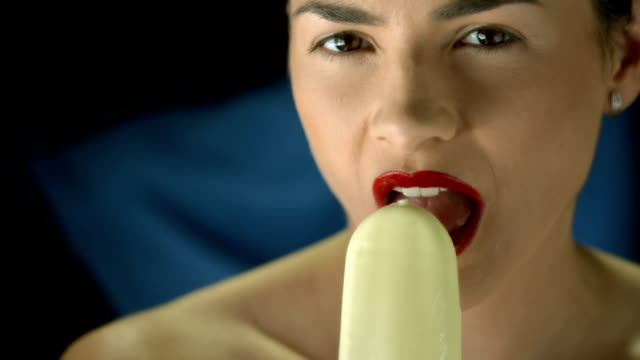 HD Super Slow-Mo: Beautiful Woman With Ice Cream