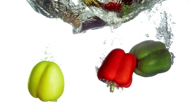 HD Super Slow-Mo: Bell Peppers Falling Into Water