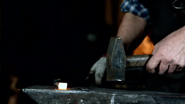 hd super slow-mo: blacksmith at work - hammer stock videos and b-roll footage