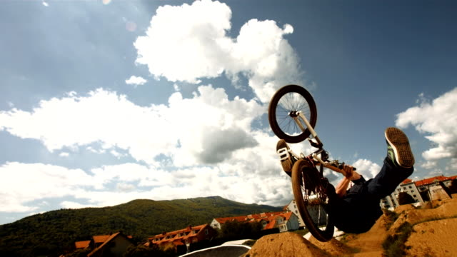 HD Super Slow-Mo: Bmx Dirt Rider Backflipping
