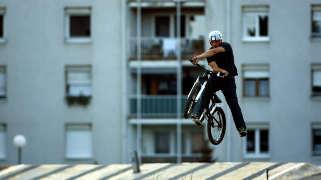 hd super slow-mo: bmx dirt rider doing x-up trick - freestyle bmx stock videos and b-roll footage