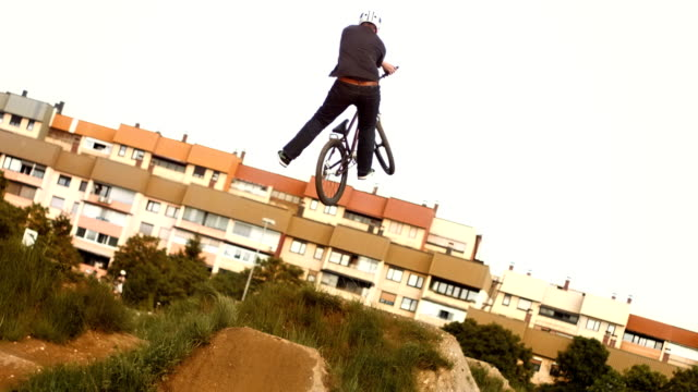 hd super slow-mo: bmx dirt rider in action - freestyle bmx stock videos and b-roll footage