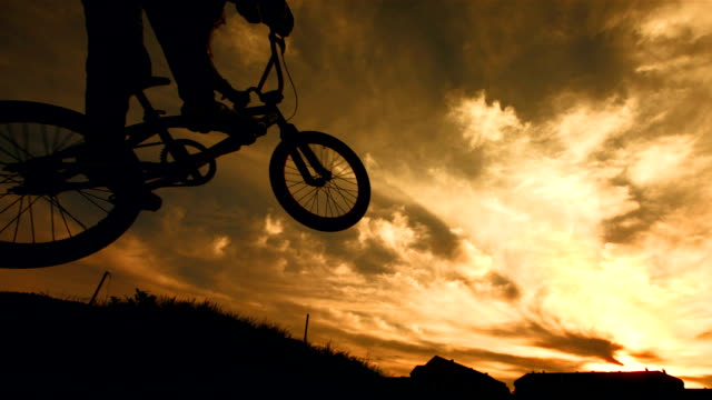 HD Super Slow-Mo: Bmx Racer Jumping At Sunset