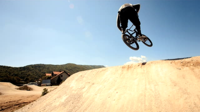 HD Super Slow-Mo: Bmx Rider Jumping Over Dirt