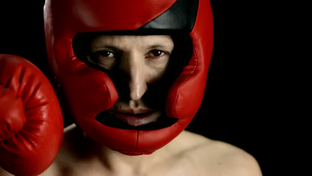 hd super slow-mo: boxer get punched in the face - punching stock videos & royalty-free footage