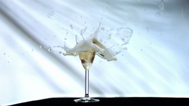 hd super slow-mo: bullet breaking a champagne flute - champagne flute stock videos & royalty-free footage