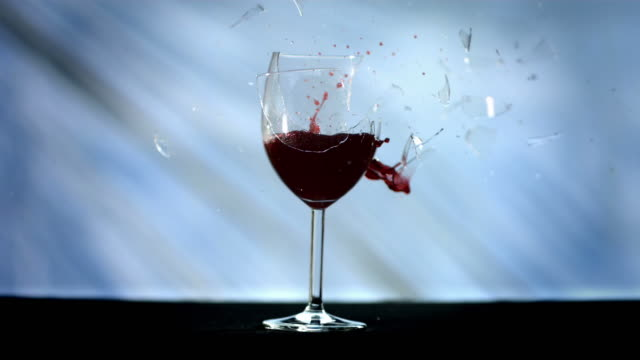 hd super slow-mo: bullet breaking a wine glass - wine glass stock videos and b-roll footage