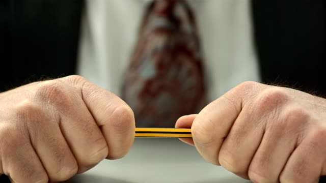 hd super slow-mo: business man breaking the pencil - ohövlighet bildbanksvideor och videomaterial från bakom kulisserna