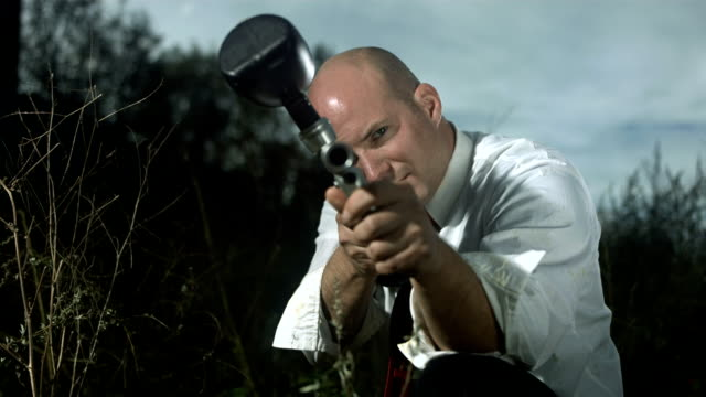 HD Super Slow-Mo: Businessman Aiming Into The Camera
