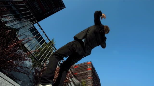 HD Super Slow-Mo: Businessman Doing A Back Somersault