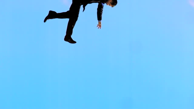 hd super slow-mo: businessman falling from the sky - falla bildbanksvideor och videomaterial från bakom kulisserna