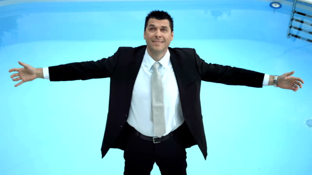 HD Super Slow-Mo: Businessman Falling Into Pool
