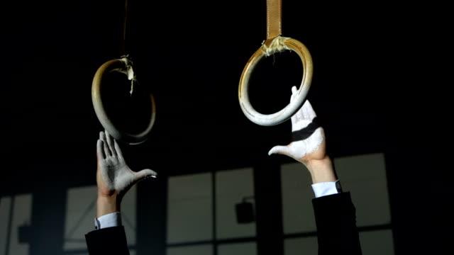 HD Super Slow-Mo: Businessman Gripping Gymnastics Rings
