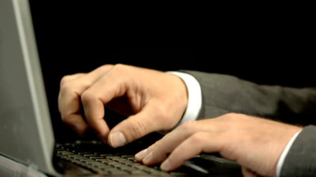 hd super slow-mo: businessman hitting laptop with fist - physical pressure stock videos and b-roll footage