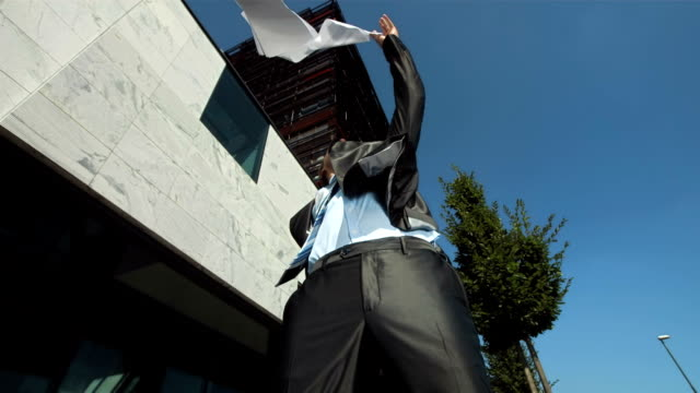 HD Super Slow-Mo: Businessman Throwing Papers Up In The Air