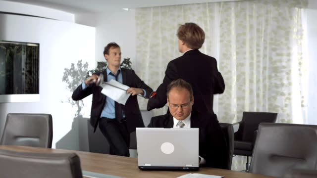 hd super slow-mo: businessmen jostling in the office - irritation stock videos & royalty-free footage