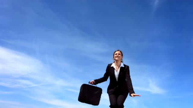 hd super slow-mo: businesswoman jumping of joy - laptop bag stock videos and b-roll footage
