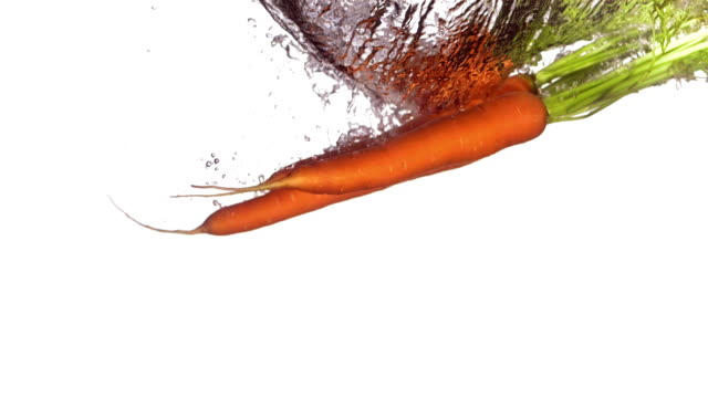 HD Super Slow-Mo: Carrots Splashing Into Water