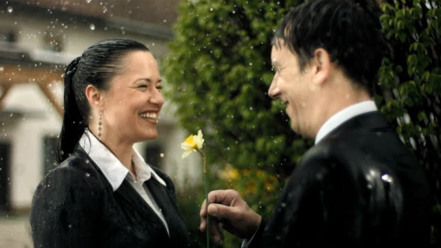 hd super slow-mo: cheerful business couple in the rain - wet stock videos & royalty-free footage