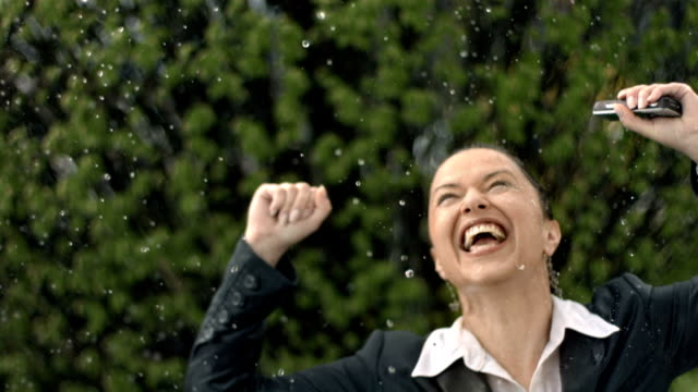 HD Super Slow-Mo: Cheerful Businesswoman In The Rain