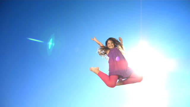 HD Super Slow-Mo: Cheerful Girl Jumping In The Air