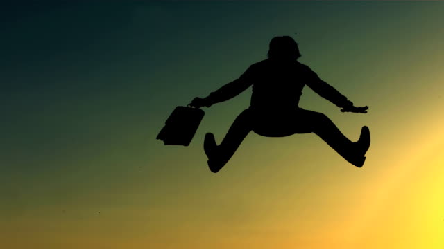 hd super slow-mo: cheerful man jumping at sunstet - good news stock videos & royalty-free footage
