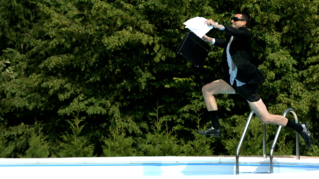 HD Super Slow-Mo: Cheerful Yuppie Jumping Into The Pool