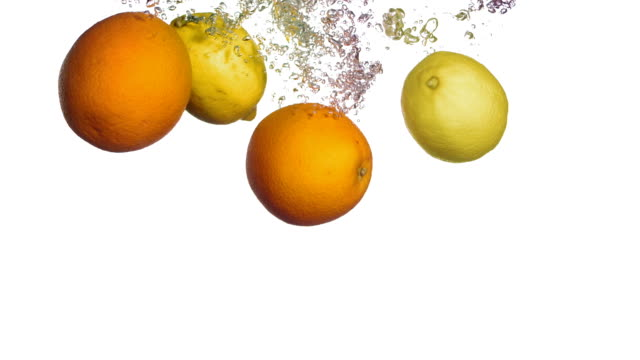HD Super Slow-Mo: Citrus Fruits Splashing Into Water