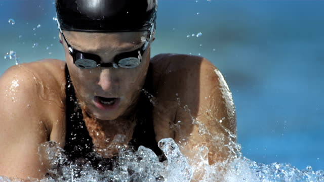 HD Super Slow-Mo: Close-Up Of A Woman Swimming Breaststroke