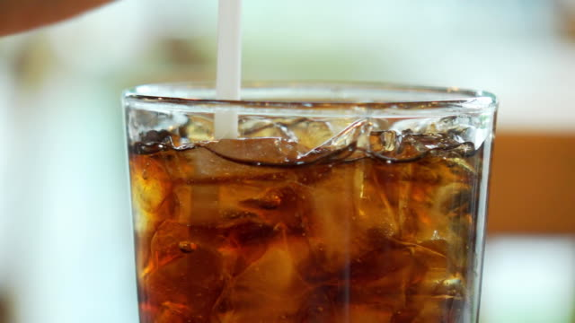 HD Super Slow-Mo :Cola into a Glass with the Ice Cubes