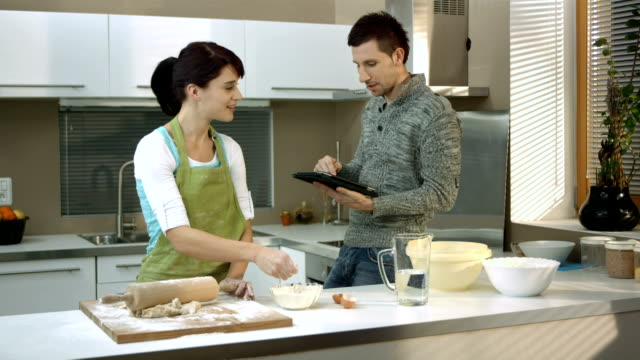 hd super slow-mo: couple having fun cooking - teasing stock videos & royalty-free footage