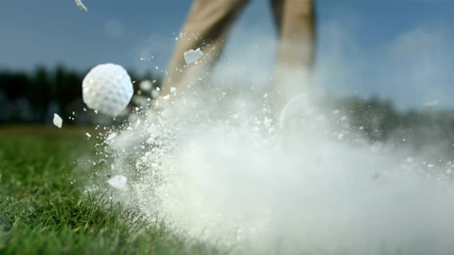 hd super slow-mo: crushing the golf ball - golf ball stock videos & royalty-free footage