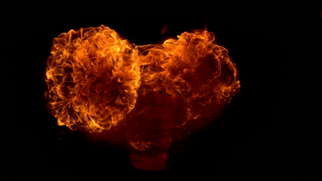 hd super slow-mo: demon blowing fire - devil stock videos & royalty-free footage