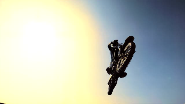HD Super Slow-Mo: Dirt Biker Jumping Over Camera
