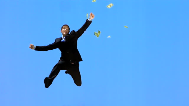 HD Super Slow-Mo: Dollars Falling Over Happy Businessman