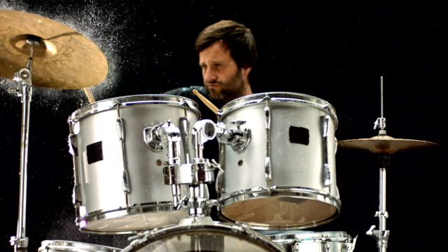 hd super slow-mo: drummer playing on wet drums - drummer stock videos & royalty-free footage